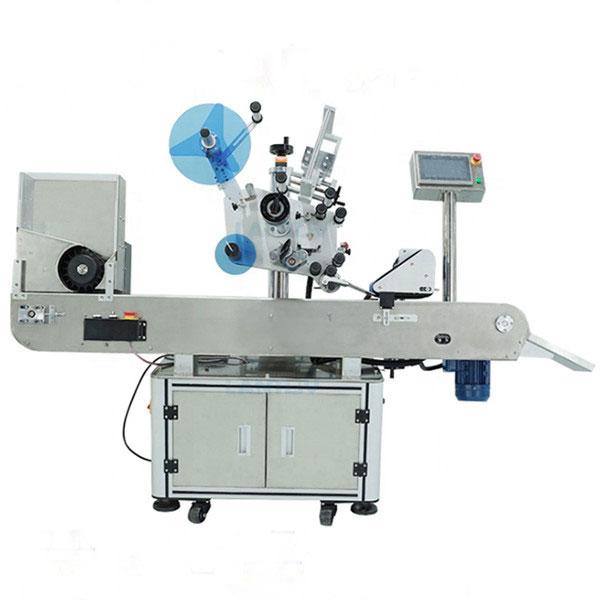 Stroj za industrijsko označavanje bočica za oralne boce s tekućinom